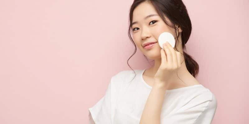 Korean woman applying toner on her skin